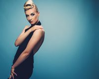 Beautiful blond woman. Fashionable woman in black with creative hairstyle Royalty Free Stock Photos