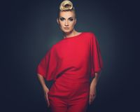 Beautiful blond woman. Fashionable woman in red with creative hairstyle Royalty Free Stock Images