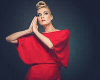 Beautiful blond woman. Fashionable woman in red with creative hairstyle Stock Photo