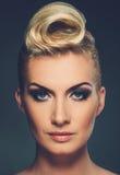 Beautiful blond woman. Fashionable woman creative hairstyle portrait Stock Photos