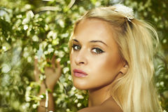 Beautiful blond woman with apple tree. flowers Royalty Free Stock Image