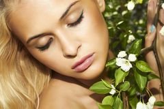 Beautiful blond woman with apple tree. summer Stock Photos
