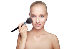 Beautiful Blond Woman applying blusher Royalty Free Stock Images