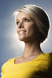 Beautiful blond woman backlit by the sun Stock Image
