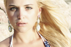 Beautiful blond woman on the beach. light on the face. sunset Stock Photos