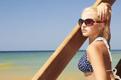 Beautiful blond woman on the beach. stairs to sea Stock Photography