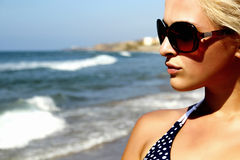 Beautiful blond woman on the beach Royalty Free Stock Images