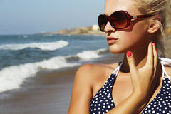 Beautiful blond woman on the beach Royalty Free Stock Photos
