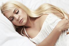 Beautiful blond woman. beauty girl. white dress. sweet dreams Royalty Free Stock Photos