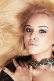 Beautiful blond woman in bijou Stock Images