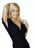 Beautiful blond woman in black dress Stock Photos