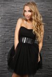 Beautiful blond woman in black dress Royalty Free Stock Photo