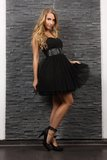 Beautiful blond woman in black dress Stock Image