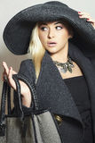 Beautiful Blond Woman in Black Hat. Fashionable Lady in Topcoat. Elegance Beauty Girl with Handbag.Shopping Autumn Stock Photography