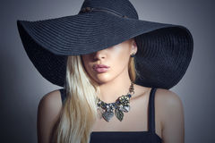 Beautiful Blond Woman in Black Hat.Lady in Jewelry. Beautiful Blond Woman in Black Hat. Elegance Beauty Girl.Spring Shopping. Accessories. Lady in Jewelry Royalty Free Stock Image