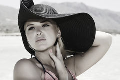 Beautiful blond woman in black hat Royalty Free Stock Photography