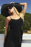 Beautiful blond woman in Black Hat and Sunglasses.summer holidays Royalty Free Stock Images