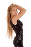 Beautiful blond woman in black shiny dress Stock Photography