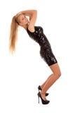 Beautiful blond woman in black shiny dress Stock Photos