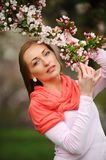 Beautiful blond woman in blossom garden. Royalty Free Stock Photo