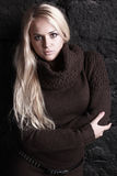 Beautiful blond woman in brown sweater Royalty Free Stock Photography