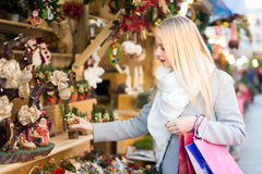 Beautiful blond woman buying decorations Stock Image