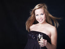 Beautiful blond woman celebrating with champagne Royalty Free Stock Photography