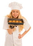 Beautiful blond woman in chef dress bakes cookies  over. White background Stock Photos