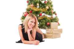 Beautiful blond woman and  Christmas tree. Royalty Free Stock Photography