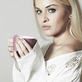 Beautiful blond woman with Coffee. Cup of tea Royalty Free Stock Photos