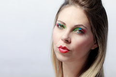 Beautiful blond woman with colorful make up. Beautiful blond woman with colorful make-up isolated on white background Stock Photos