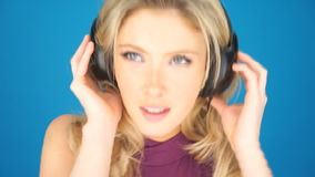Beautiful blond woman concentrating on her music stock video