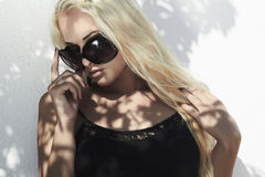 Beautiful blond woman in daylight.shadows on the face.girl.top model Royalty Free Stock Photos