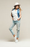 Beautiful blond woman in denim waistcoat and cat Royalty Free Stock Photography