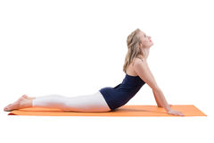 Beautiful blond woman doing stretching muscles of the back, legs. Royalty Free Stock Images