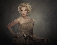 Beautiful blond woman in a dress Stock Images