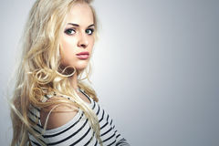Beautiful blond woman in dress.Curly Beauty Girl.Your text here Royalty Free Stock Photos