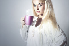 Beautiful blond woman drinking Coffee. Cup of tea Stock Photos