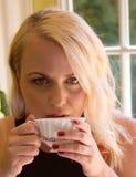 Beautiful Blond Woman Drinking Coffee Royalty Free Stock Photo