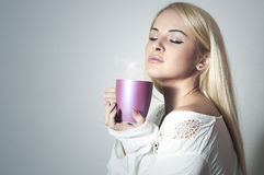Beautiful blond woman drinking Coffee.Sweet girl in the Morning Stock Photos