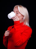 Beautiful blond woman drinking tea Stock Photos