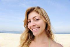 Beautiful blond woman enjoying the beach Stock Photo