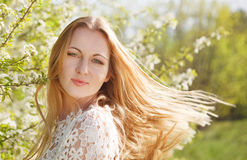 Beautiful blond woman enjoying spring day Royalty Free Stock Image