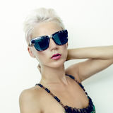 Beautiful blond woman in fashionable glasses Stock Photography
