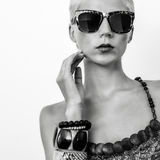 Beautiful blond woman in fashionable glasses Royalty Free Stock Image