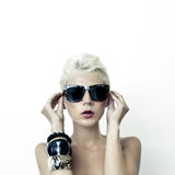 Beautiful blond woman in fashionable glasses Stock Image