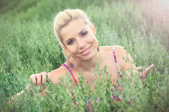 Beautiful blond woman in a field. Portrait of beautiful blonde in a oat field, fashion photography Royalty Free Stock Image