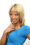 Beautiful blond woman with finger on her lips Stock Photo
