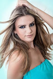 Woman flipping hair. Beautiful blond woman  flipping hair Royalty Free Stock Images