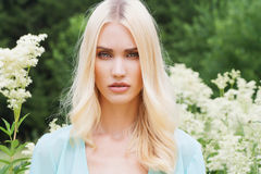 Beautiful Blond Woman with flowers Stock Photography